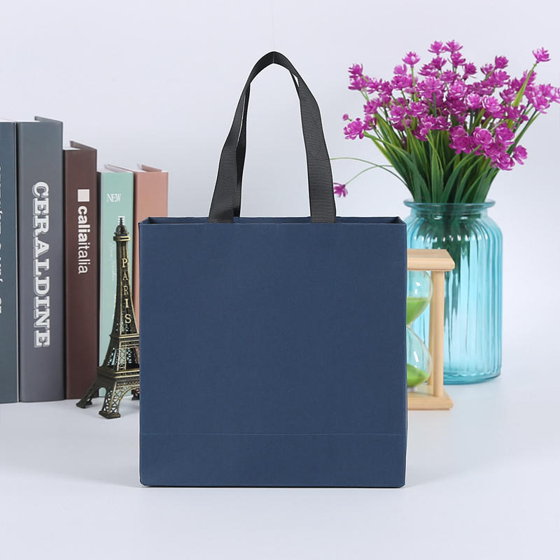 Blue paper gift bags clothing bags with handle | shopping bags with your logo printed